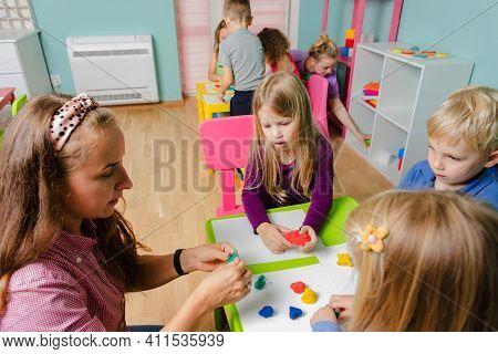 The Happy Children With Tutors Sculpt From Plasticine