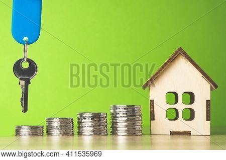 House Of Coins House Keys, The Concept Of Buying Property On A Green Background