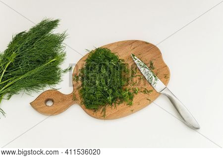 Chopping Board And Chopped Greens, On A White Background