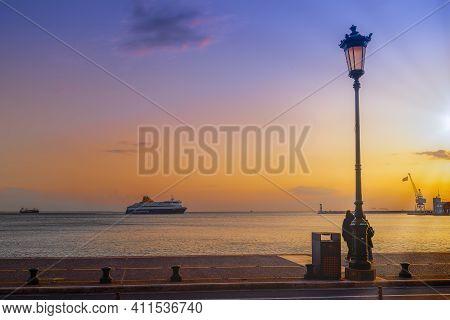 Thessaloniki, Greece - March 6 2021: Blue Star Mykonos Passenger Ship Sailing To City Seaport At Sun