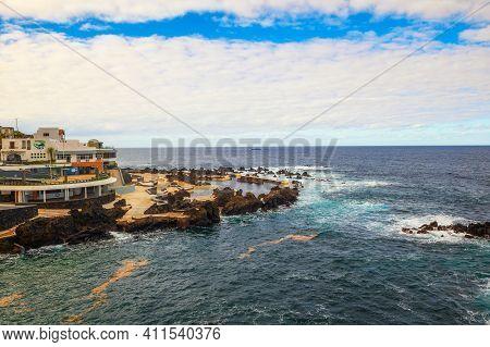 Porto Moniz, Madeira, Portugal - January 13, 2021 : Natural Swimming Pools Of Porto Moniz