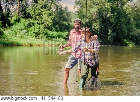 Rod Tackle. Fishing Equipment. Hobby Sport. Fishing Peaceful Activity. Father And Son Fishing. Grand