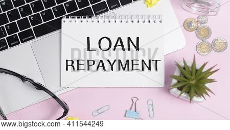 Loan Repayment Word On A Notebook - Finance Conceptual
