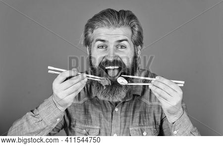 Hipster Eat Sushi With Chopsticks. Tasty Sushi Roll. Traditional And Healthy Food In Japan. Japanese