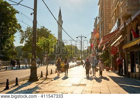 People Walk Along The Sidewalk At Sultanahmet Square In Istanbul. Turkey , Istanbul - 21.07.2020