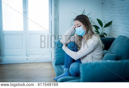 Lonely Woman With Face Mask Suffering From Depression At Home In Quarantine Lockdown Amid Covid-19