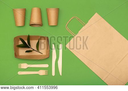 Eco-friendly Disposable Packaging, Paper Tableware On Green Background, Waste Recycling Concept, Pla