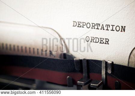 Deportation order phrase written with a typewriter.