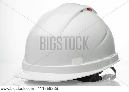White Construction Workers Helmet On A White Background With Preserved Paths