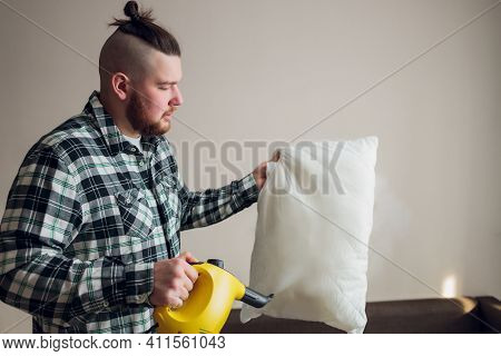 Dry Cleaning Worker Removing Dirt From Sofa Cushion Indoors.