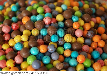 Multicolored Candies Background. Chocolate Candy Dragees Covered With Colored Glaze.