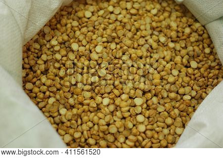 Dried Chickpeas In The Sack. Sack Of Split Peas Close Up. Vegan Food Concept.