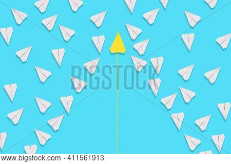 A Yellow Paper Airplane Flies Confidently Among The White Planes In Search Of A New Solution. Blue B
