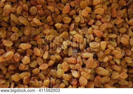 Dried Golden Raisins Background. Pile Of Dried Yellow Raisins.