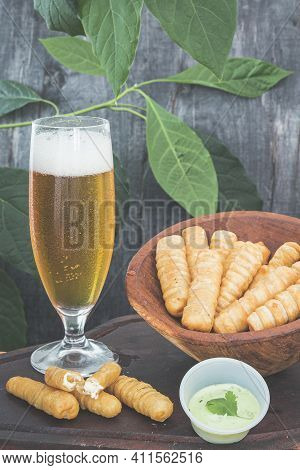 Traditional Venezuelan Cheese Sticks Tequeños With A Cold Beer