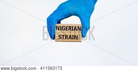 Covid-19 New Nigerian Strain Symbol. Hand In Blue Glove Holds Wooden Blocks, Words 'nigerian Strain'