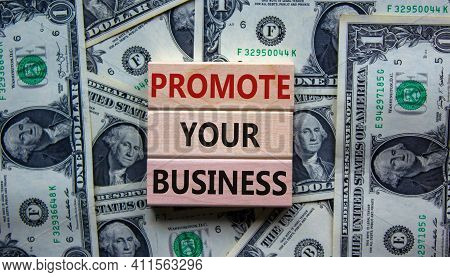 Promote Your Business Symbol. Wooden Blocks With Words 'promote Your Business' On Beautiful Backgrou