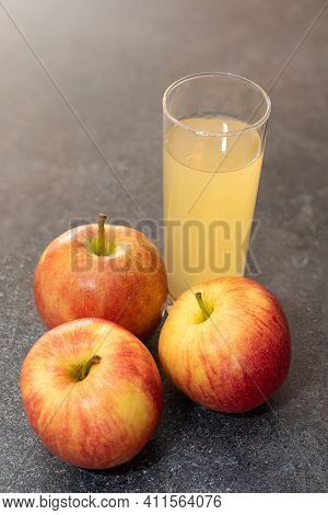 Apple Juice From Red Apples Fruits In A Glass. Food And Beverage Picture.