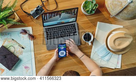 Top View Of Young Man With Laptop Planning Vacation Trip Holiday, Desktop Travel Covid-19 Concept