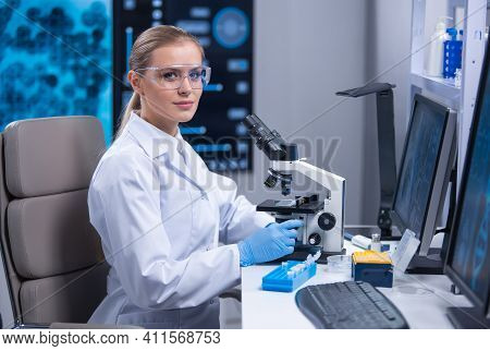 Professional Female Scientist Is Working On A Vaccine In A Scientific Research Laboratory. Genetic E