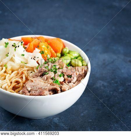 Poke Bowl, Pulled Pork, Vegetables, Pumkin, Soy Beans Edamame, Noodles, On Bowl, Chopsticks. Copy Sp