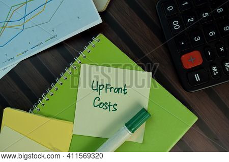 Upfront Costs Write On Sticky Notes Isolated On Wooden Table.