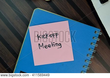Kickoff Meeting Write On Sticky Notes Isolated On Wooden Table.