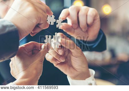 Businessman Team Work Holding Two Jigsaw Connecting Couple Puzzle Piece For Matching To Goals Target
