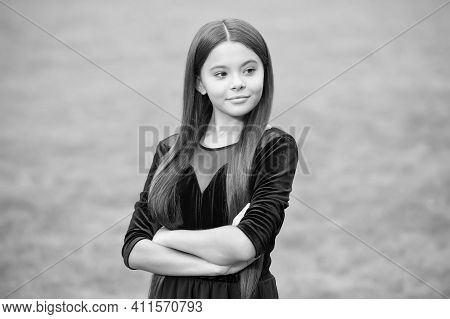 Feeling Confident. Confident Girl Keep Arms Crossed Green Grass. Beauty Look Of Little Fashionista.