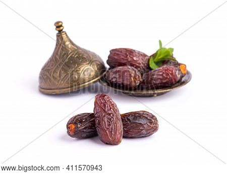 Hurma, Dates. Dried Dates Fruit With Bronze Bowls On White Background. Popular Fruit Of Ramadan.