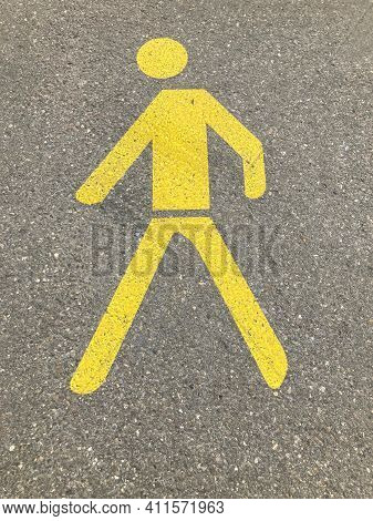 Yellow Painted Pedestrian Crossing Sign Or Pathway Sign On Asphalt In Switzerland