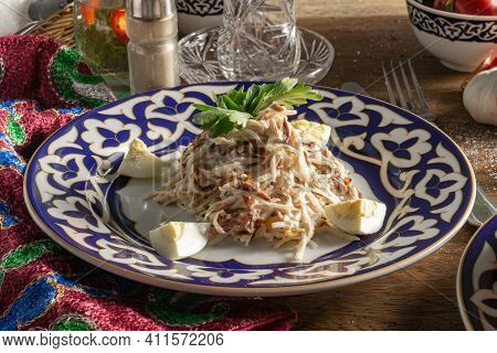 Traditional Uzbek Tashkent Salad Of Beef, Daikon Radish And Fried Onion, Boiled Egg And Parsley With
