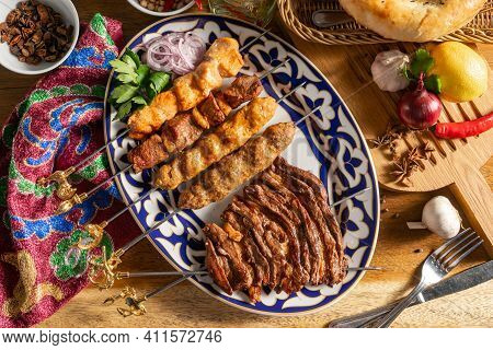 Platter Of Kebabs. Uch-panzha Of Lamb, Kebab Chicken Kebab With Lamb, A Shish Kebab Of Chicken And L