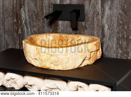 Sink Made From A Piece Of Marble Stone. Modern Bathroom With Homemade Marble Stone Sink. Sink Made O