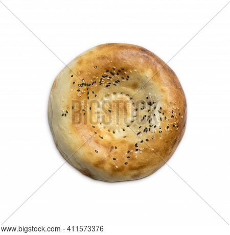 Traditional Uzbek Flatbread With Sesame Seeds On A White Background. Eastern Pastries From The Tando