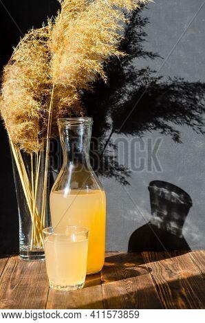 Homemade Ginger Kombucha Or Kvass In A Bottle. A Healthy Fermented, Prebiotic Drink. Dark, Wooden Ba