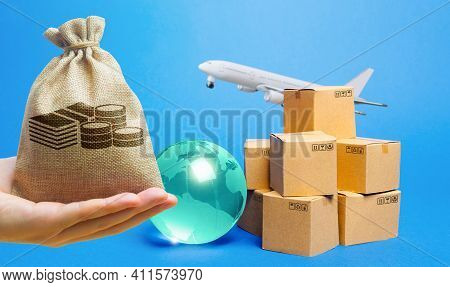 Money Bag, Blue Globe, Cardboard Boxes And Freight Airplane. International World Trade. Deliver Good