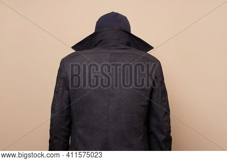 Rear View On Man Dressed As Criminal Person.
