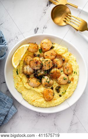 Seared Scallops With Grits And Lemon Butter Sauce