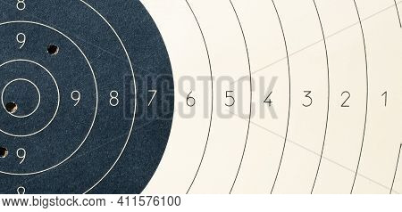 Target With Numbers For Shooting At A Shooting Range. A Round Target With A Marked Bulls-eye For Sho