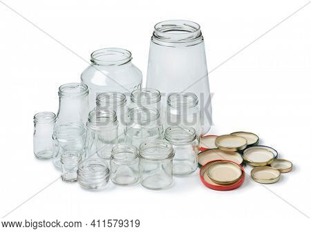 Recycled empty glass jars isolated on white background