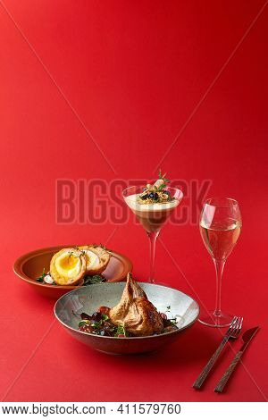 Brunch Dinner Menu. Snack - Scottish Eggs, Fried Quail And Dessert - Trio Muss Red Background.