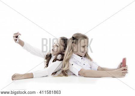 Schoolgirls Smartphones Surfing Internet Social Networks. Send Message. Online Communication. Create