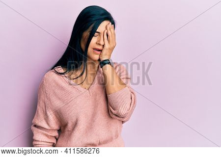 Young caucasian woman wearing casual clothes yawning tired covering half face, eye and mouth with hand. face hurts in pain.