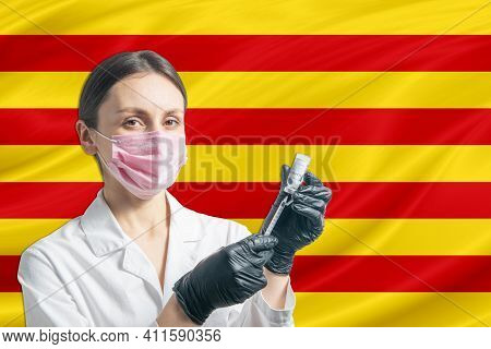 Girl Doctor Prepares Vaccination Against The Background Of The Catalonia Flag. Vaccination Concept C