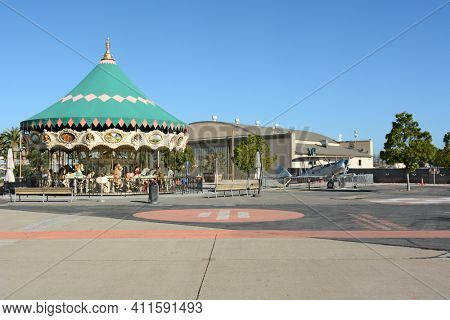 IRVINE, CA - FEBRUARY 10, 2015: The Orange County Great Park Carousel Ride, with vintage airplane and hangar. The park is being built on the former Marine Corps Air Station, El Toro.