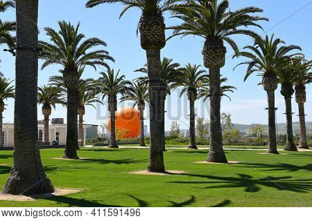 IRVINE, CALIFORNIA - MARCH 28, 2017: Tethered Balloon and the Great Park Palm Court in Irvine. The Great Park will be the largest urban park since Central Park in NY.