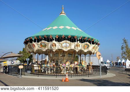 IRVINE, CA - OCTOBER 14, 2016: The Orange County Great Park Carousel Ride. The carousel ride is one of two current attractions at the Great Park, the other being the balloon.