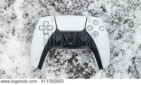 Moscow, Russia - March 8 2021: Presentation Of A New Product From Sony - A White Wireless Gamepad Pl