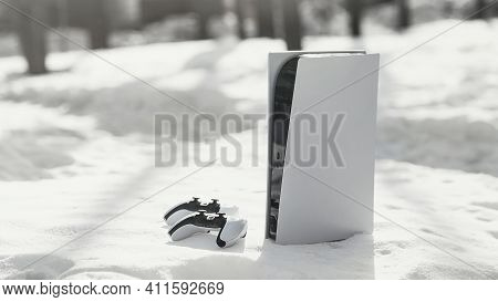 Moscow, Russia - March 8 2021:  Sony Playstation 5 Home Video Game Console And Game Controller. New